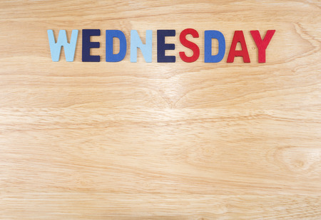 weekdays: Wednesday word by wooden letters on wood background (Weekdays word series)