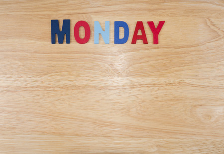 weekdays: Monday word by wooden letters on wood background (Weekdays word series)