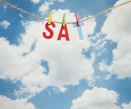 weekdays: Sat word by wooden letters hang with rope on blue sky background (Weekdays word series)
