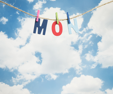 weekdays: Mon word by wooden letters hang with rope on blue sky background (Weekdays word series)