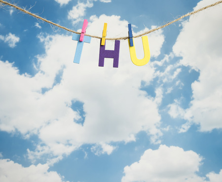 weekdays: Thu word by wooden letters hang with rope on blue sky background (Weekdays word series)