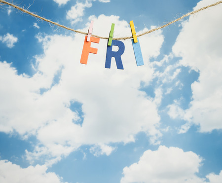 weekdays: Fri word by wooden letters hang with rope on blue sky background (Weekdays word series)