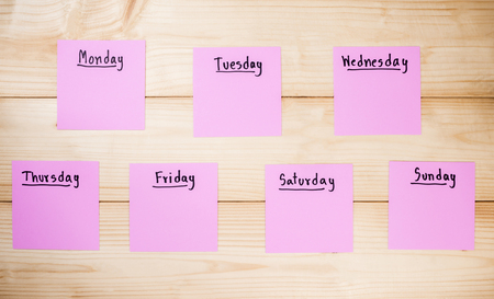 sunday paper: Name of 7 days in paper note on wood background Stock Photo