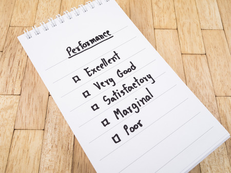 marginal: Performance Evaluation check box on white notebook (Business concept) Stock Photo