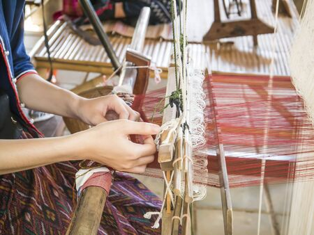 handloom: Woman are weaving silk by traditional way in Thailand