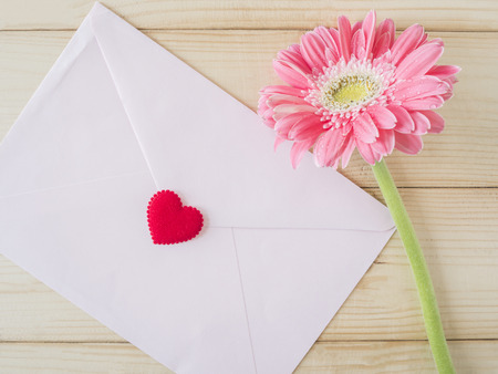 envelope decoration: Pink flower and pink envelope in love concept on wood background, Valentines day