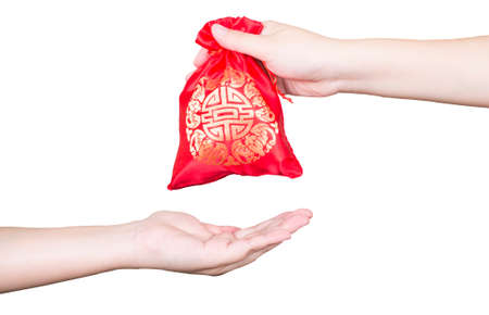 someone: Woman give red bag to someone for Chinese New Year on isolated  white background