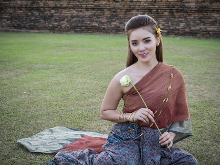 traditional culture: Thai woman wearing Thai traditional dress at the historical park, identity culture of Thailand.
