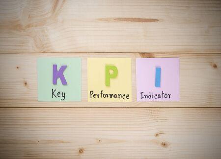 KPI (Key Performance Indicator) with wood background (Business concept) Stock Photo