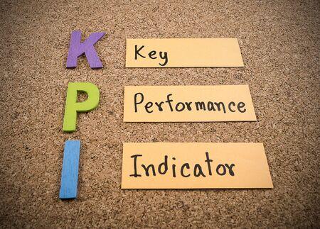 kpi: KPI (Key Performance Indicator) on cork board background (Business concept)