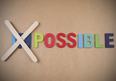 transformed: Wooden word impossible transformed into possible. Motivation with business concept Stock Photo