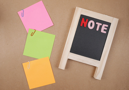 and spelling: Word spelling Note on black broad and colorful sticky note with brown paper background (Business concept)