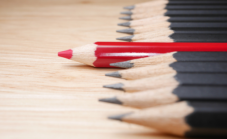 standout: Red pencil standout from black pencil, leadership business concept