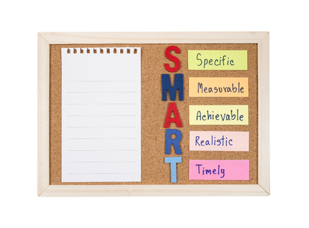 Blank notepaper and SMART Goals with cork board on isolated / white background (Business Concept) Stock fotó