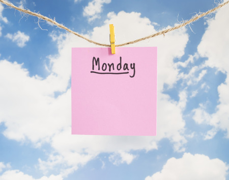 weekdays: Monday handwriting on colorful notepaper hang with rope on blue sky background (Weekdays word series) Stock Photo