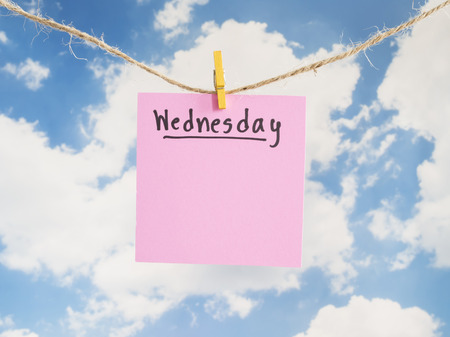 weekdays: Wednesday handwriting on colorful notepaper hang with rope on blue sky background (Weekdays word series) Stock Photo