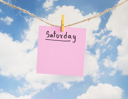 weekdays: Saturday handwriting on colorful notepaper hang with rope on blue sky background (Weekdays word series)