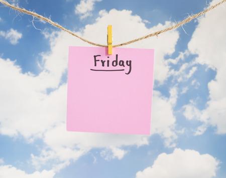weekdays: Friday handwriting on colorful notepaper hang with rope on blue sky background (Weekdays word series)