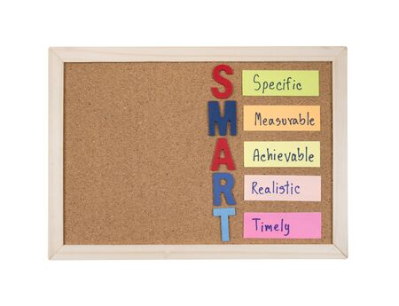 achievable: SMART Goals with cork board on isolated  white background (Business Concept) Stock Photo
