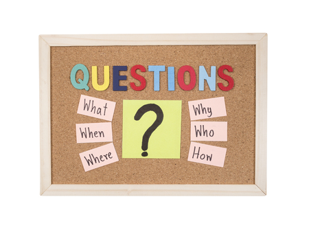 when: Questions what, when, where, why, who, how on cork board background Stock Photo