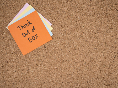 think out of the box: Handwriting word Think out of box on colorful note paper with cork board background