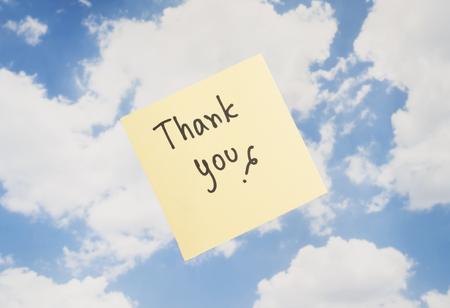 thankfulness: Word Thank you on colorful note paper with blue sky background