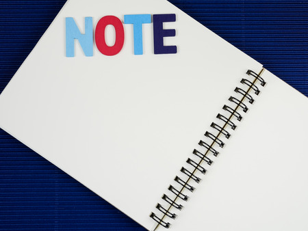corrugate: Word Note on notebook with blue corrugate paper background (Business concept) Stock Photo