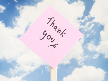 gratefulness: Word Thank you on colorful note paper with blue sky background