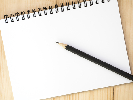 take a note: Blank notebook and black pencil put on wood background for take a note Stock Photo