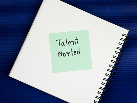 corrugate: Handwriting Talent Wanted on blank notebook with blue corrugate paper background (Business Concept) Stock Photo