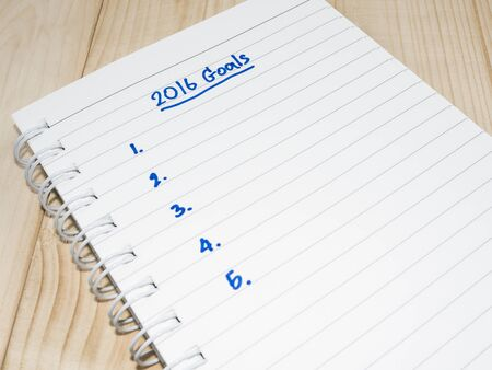 persuade: 2016 Goals in notebook on wood background (Business Concept) Stock Photo