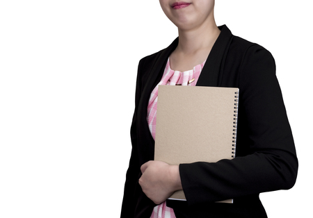 hand wear: One smart business woman wear black suit and hold brown notebook in left hand stand on isolatedwhite background (Business concept) Stock Photo