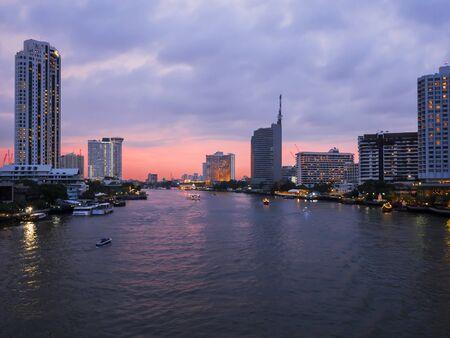chao phraya: Cityscape and modern building near the river, Night light at Chao Phraya River in Bangkok, Thailand Stock Photo
