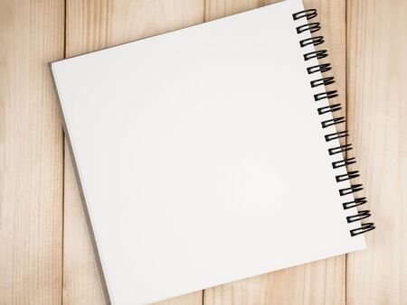 take a note: Blank notebook on wood background for take a note