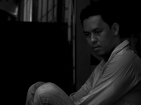 despondent: Black and white portrait of lonely  disappointed  unhappy businessman sitting on the stairs in black corner (Dark tone)