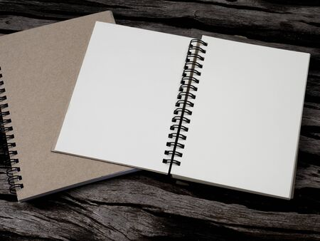 take a note: Blank notebook on wood background for take a note (Dark color tone)