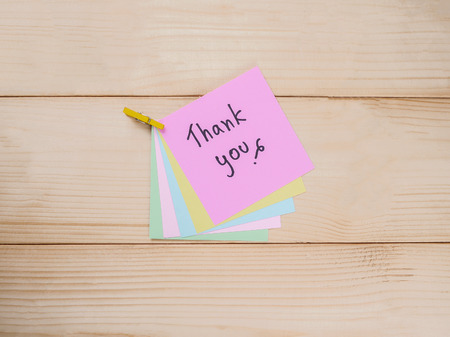 gratefulness: Handwrithing Thank you on colorful note paper with wood background Stock Photo