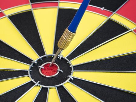 Blue dart arrows in the center of dart board. (Selective focus)