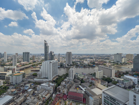 chao phraya river: Cityscape and modern building near Chao Phraya River river in the afternoon at Bangkok, Thailand under blue sky and cloud