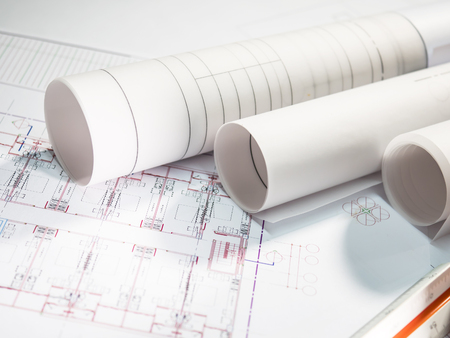 Architect plan rolls on the table with Selective focus