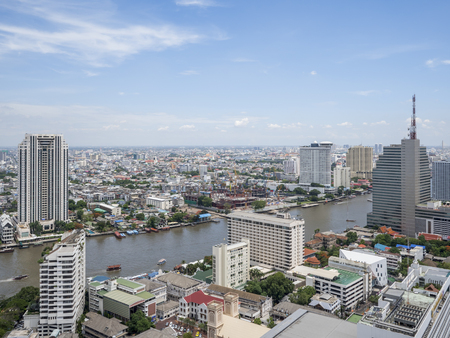 chao phraya: Cityscape and modern building near Chao Phraya River river in the afternoon at Bangkok, Thailand under blue sky and cloud