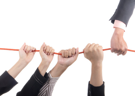 coporate: Business people hold rope on isolated  white background with leader concept Stock Photo