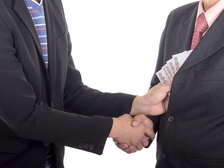 corruptible: Businessman giving a bribe to the pocket for corruption something on isolated  white background