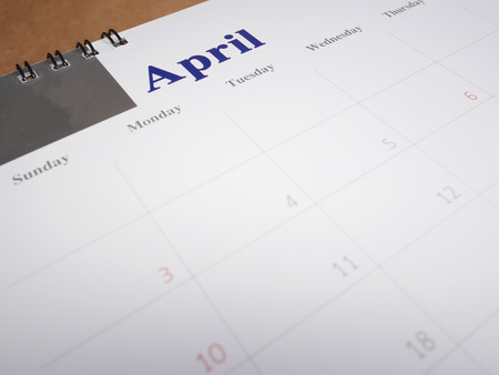 April on calendar page, desk calendar on wood background (Selective focus) Stock Photo