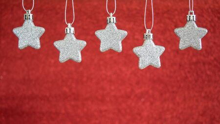 red blur: Silver star hang on red blur background, Christmas background Stock Photo