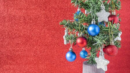 red blur: Silver star and red, blue christmas ball hang on Christmas tree with red blur background