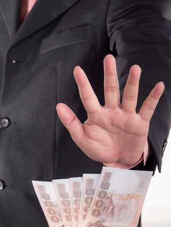 venal: Businessman decline a bribe on isolated  white background. Stop corruption and fraud concepts Stock Photo