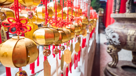 Closeup golden ball hanging for good luck at Wenwu Temple, Taichung, Taiwan (Chinese traditional belief)