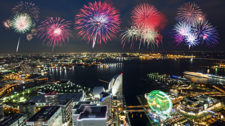 Firework with night light Yokohama cityscape hight view with modern building in Japan Stock Photo