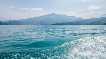 Water surface in the lake on the boat with landscape of mountain view at Sun Moon Lake, Nantou city, Taiwan